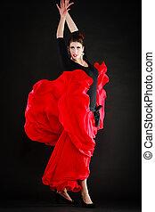 Dance. Spanish girl in red skirt dancing flamenco