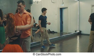 Dance students repeating teacher's movements - Dance...