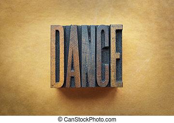 Dance - The word DANCE written in vintage letterpress type.