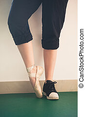 dancer girl feet in sneakers and ballet shoes closeup