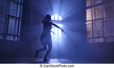 Dancer girl in white dress dancing contemporary, silhouette. Slow motion