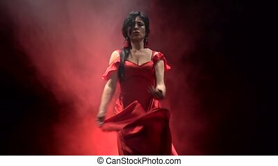 Dancer in a chic dress turns in an incendiary dance of...