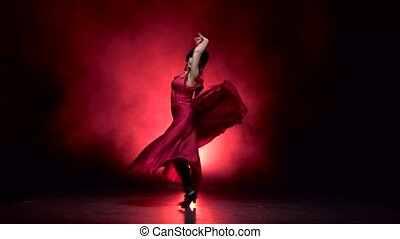 Dancer in an incendiary dance of Argentine flamenco. Light...