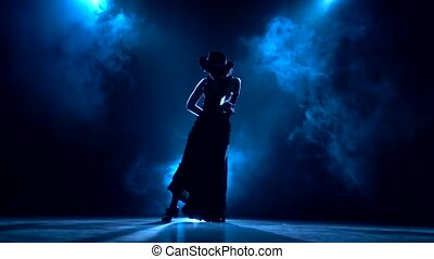 Dancer in an incendiary dance of Argentine flamenco . Llight...