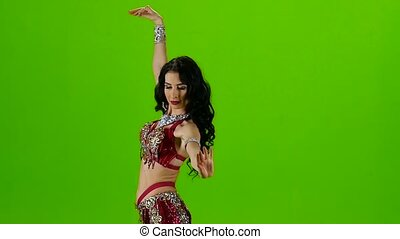 Dancer in red dress. Green screen. Slow motion