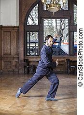 Dancer In Suit Performing Argentine Tango