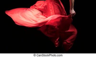Dancer in the rhythm of the music develops the skirt. Black...