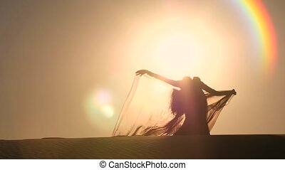 Dancer makes sexual movements with her body. Silhouette -...