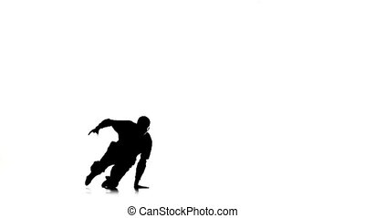 Dancer man dancing breakdance moves, white, silhouette, slow motion