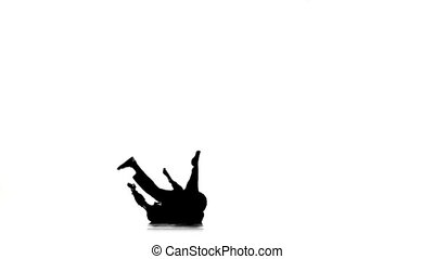 Dancer man dancing breakdance professional moves, white, silhouette, slow motion