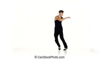 Dancer man in black pullover dancing breakdance on white