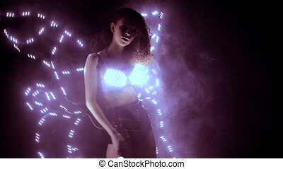 Dancer performing in led costume with butterfly wings -...