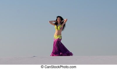 Dancer performs sexual movements with her body against the...