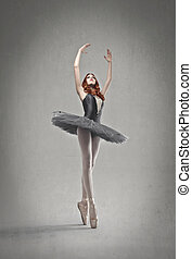dancer posing - dancer with black tutu posing on a gray...