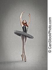dancer posing - dancer with black tutu posing on a gray ...