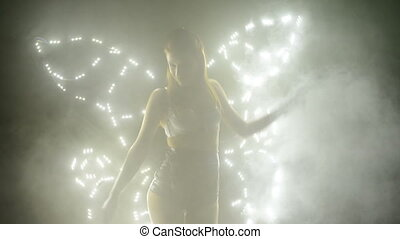 Dancer posing in led costume with butterfly wings