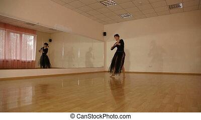 Dancer Practicing in dance studio