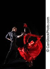 dancers against black background in action - dancers against...