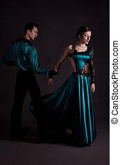 Dancers against black background
