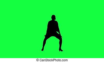Dancer's silhouette against a green
