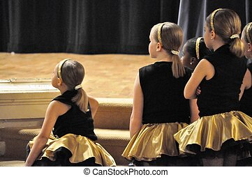 Dancers wait and watch