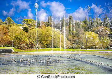 Dancing and singing fountains in the city park in France