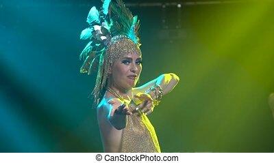 Dancing and singing Greek Goddess Artemis on stage in a dark...