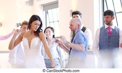 Dancing At A Wedding - Bride dancing with her father and all...