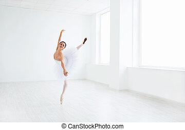Dancing - Beautiful ballerina dancing in studio