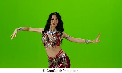 Dancing belly dance with red dress. Green screen. Slow...