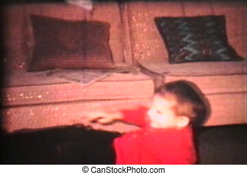 A hyper fun loving little boy breaks out into a crazed dance fever in the living room. (Scan from archival 8mm film)