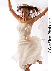 Dancing Bride - Happy Bride dances on white studio...