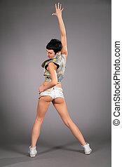 dancing brunette in shorts