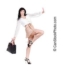 Dancing brunette lady with handbag