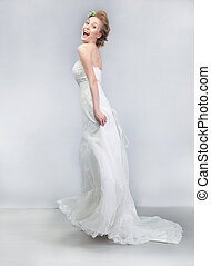 Dancing cheerful bride in long wedding white dress - Wedding...