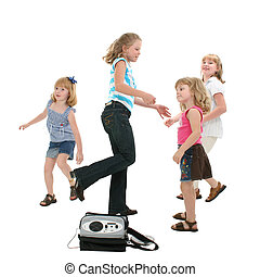 Dancing Children - Group of children dancing to portable DVD...