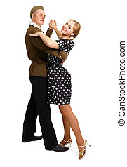 Dancing couple dressed in 60s