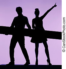 Dancing couple holding the board