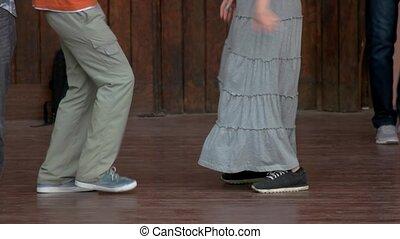 Dancing couple legs.