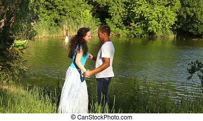 Dancing couple near water