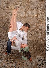 Dancing couple - Portrait of young hispanic couple dancing...
