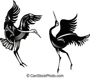 Dancing cranes silhouettes