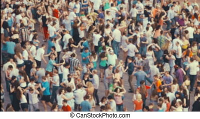 Dancing crowd of people in city center