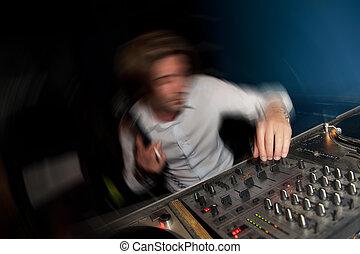 Dancing DJ in a disco pub