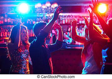 Dancing - Energetic friends dancing in night club