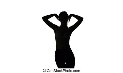 Dancing erotic young woman, isolated silhouette
