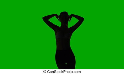 Dancing erotic young woman, silhouette