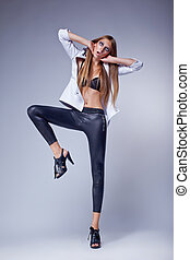 Dancing fashion provocative bright girl in stylish leggins