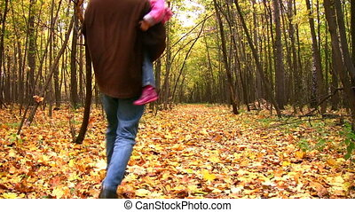 dancing father with girl in autumn park
