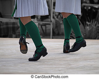 Dancing Feet - The feet of two dancers performing an Irish...